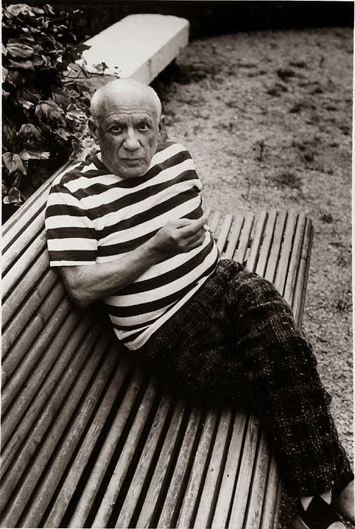 Pablo Picasso wearing a striped tee shirt